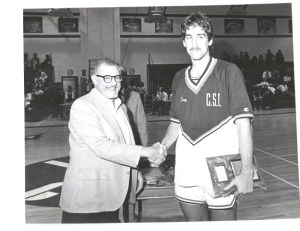 A young Tony Petosa accepts an award during his playing days of the 80s. (CSI Athletics)