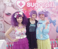 The ladies at the Sugarpill make-up booth greet guests with bright outfits and smiles