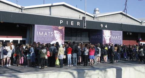 At 8AM, students, make-up artists, and fans await the opening of the doors at Pier 94 in NYC for this year's IMATS