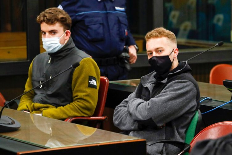 FILE -- In this April 29, 2021 file photo, Gabriel Natale-Hjorth, left, and his co-defendant Finnegan Lee Elder, both from the United States, wear face masks to curb the spread of COVID-19 as they sit during a break of a hearing of their trial in Rome. A jury will soon be weighing the fate of the two young American men, charged with slaying an Italian police officer while they were on holiday in 2019. (Remo Casilli/Pool Photo via AP)